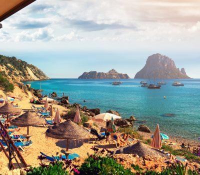 Small Cala d'Hort beach, with a fantastic view of the mysterious island of Es Vedra. Ibiza Island, Balearic Islands. Spain