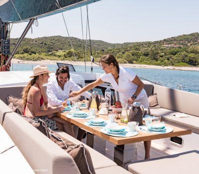 Stewardess serving breakfast - under anchor
